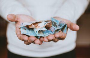 euro-notes-in-hands-vat-post