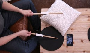 senstroke on table with cushion drumming pad and smartphone app